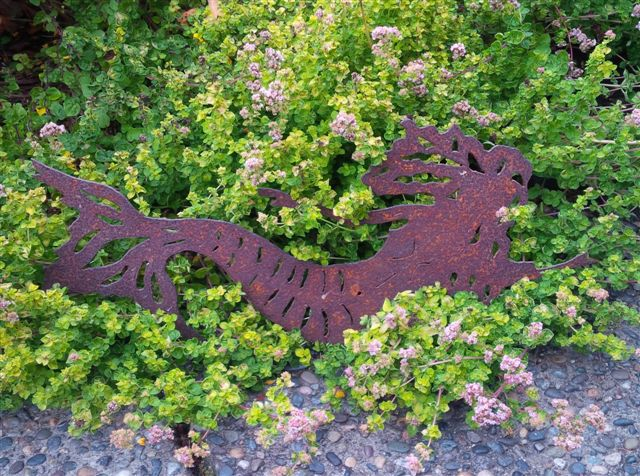 oxidized mermaid on bed of herbs